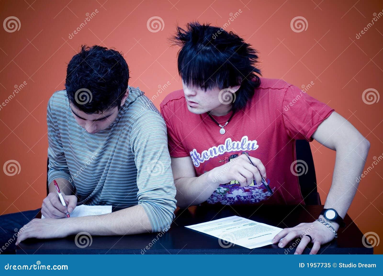 Two Teens Taking Exam