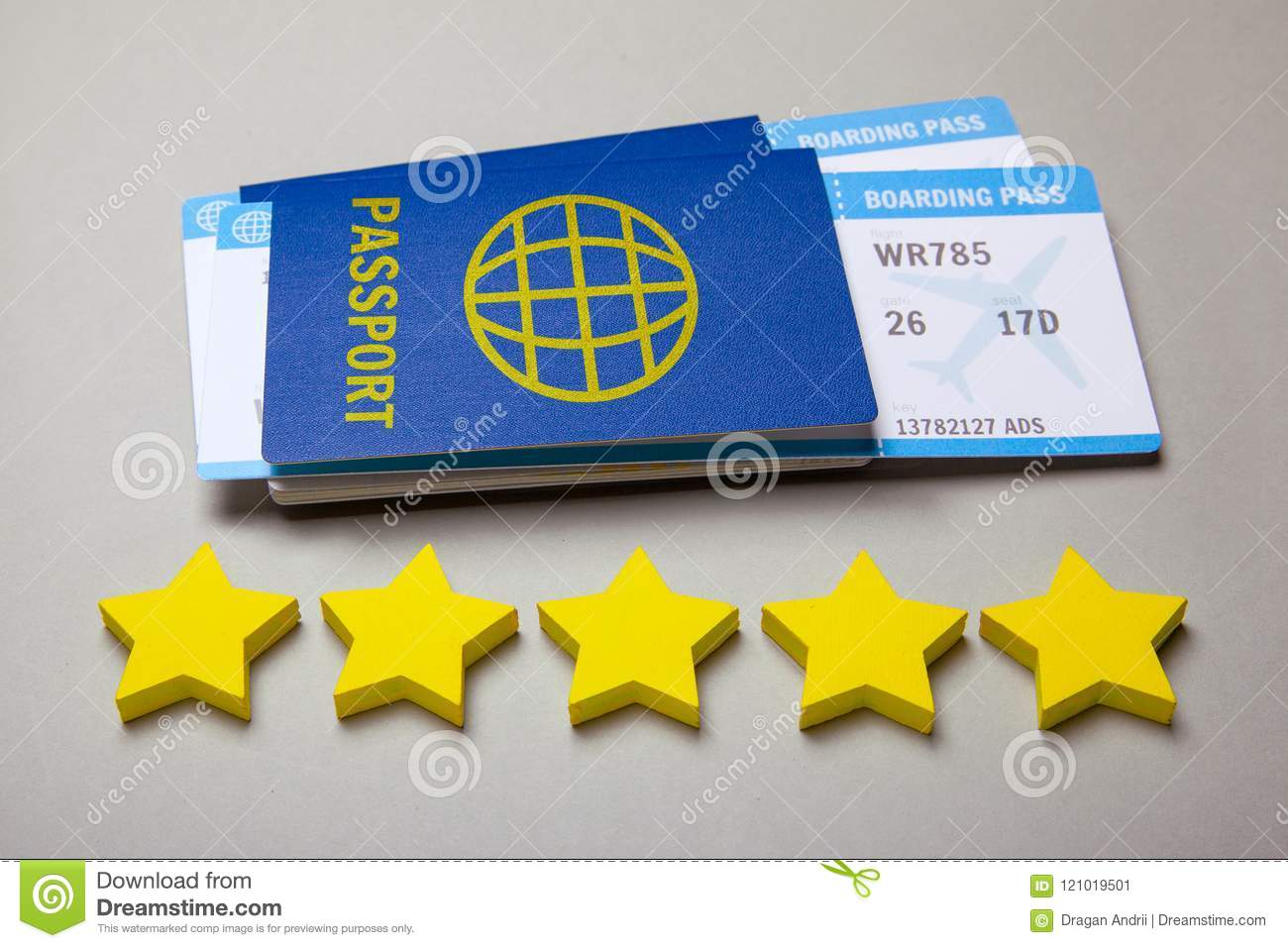 Two Tickets For Airplane With Passports On Gray  Five Stars Of The