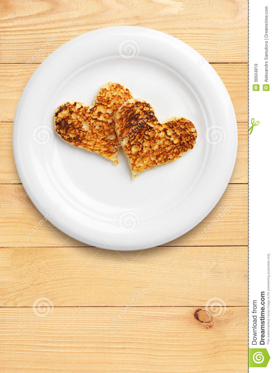 Two toast bread in the shape of hearts