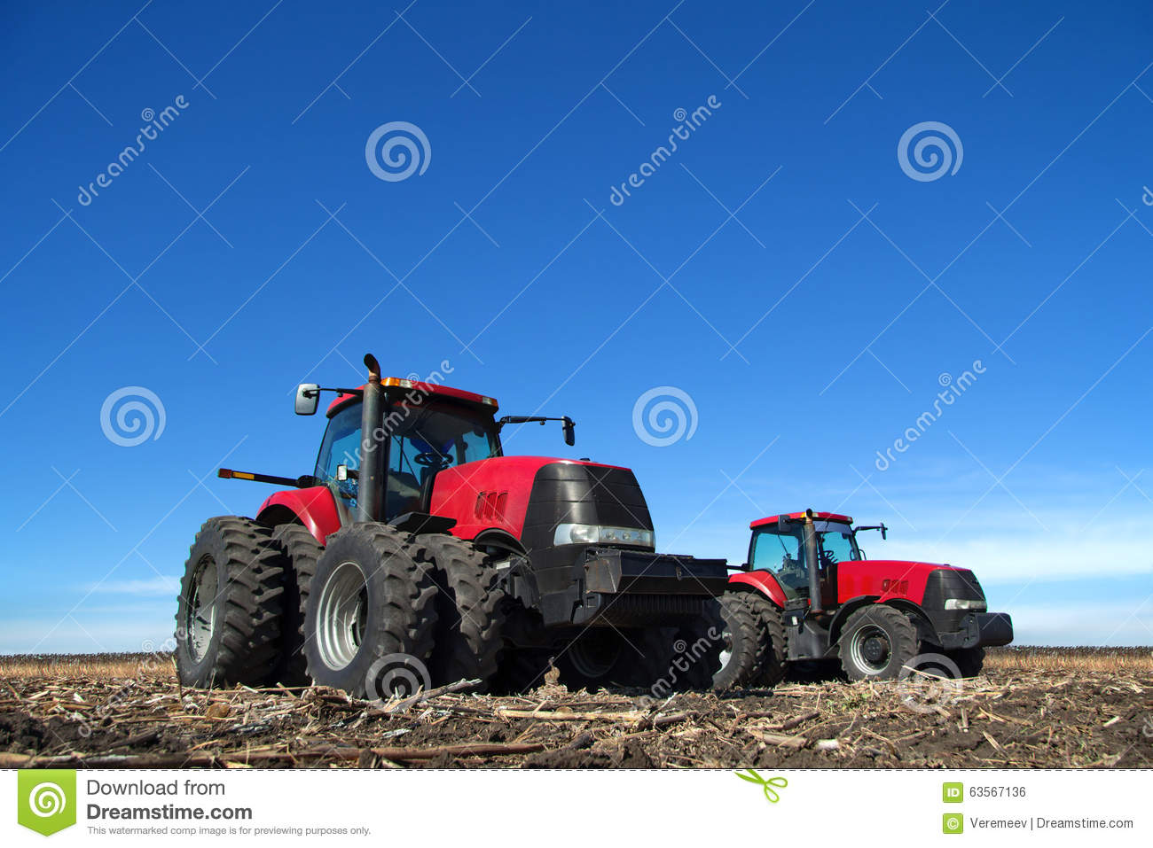 Two Tractor Cultivating The Land Stock Photo - Image: 63567136