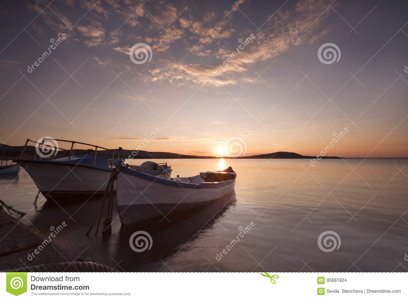 Two traditional wooden fishing boats in the sea. Fishing boats t