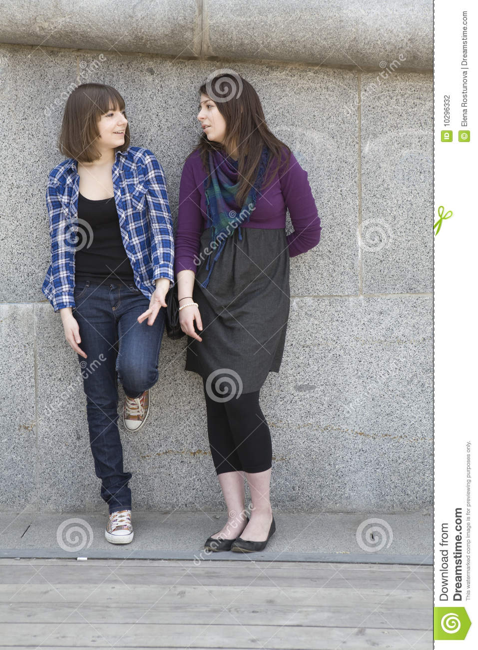 two urban teen girls standing at wall stock photo image