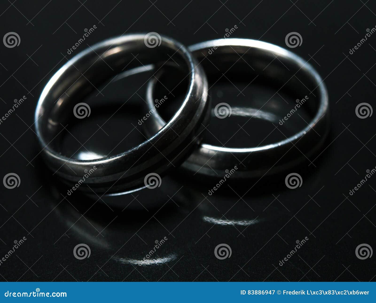 Used Wedding Rings.Two Used Wedding Rings On Black Background Stock Image Image Of