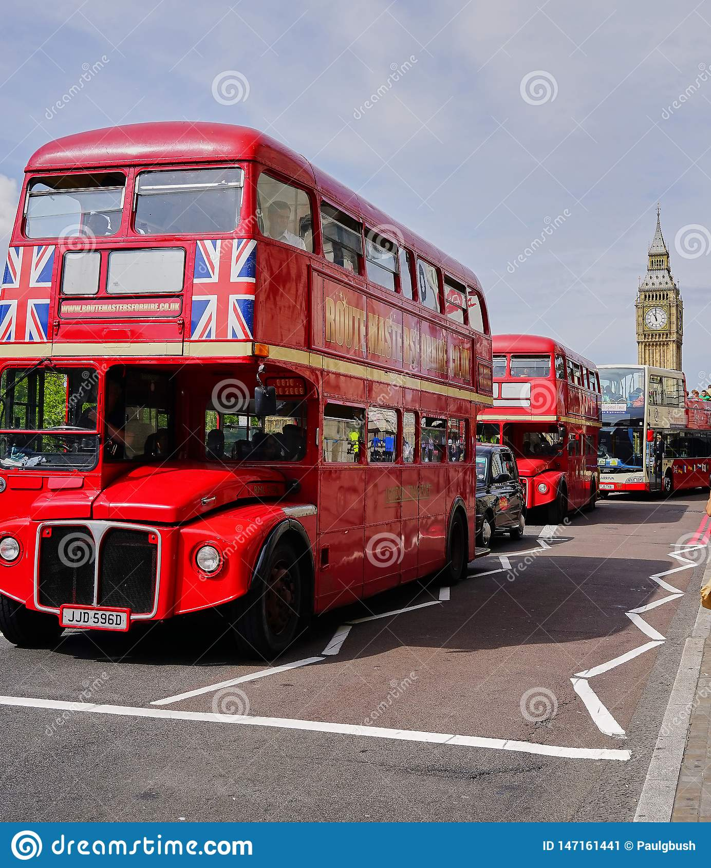 Line of Red Double Decker Buses near Big Ben - London