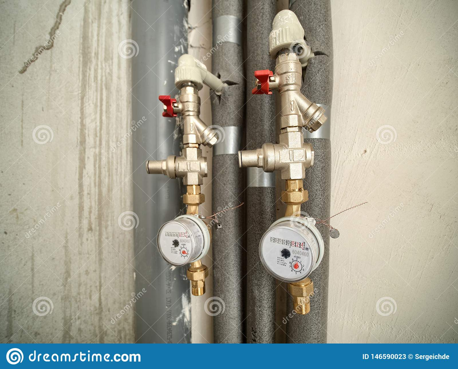 Two water meters in bathroom of new flat.