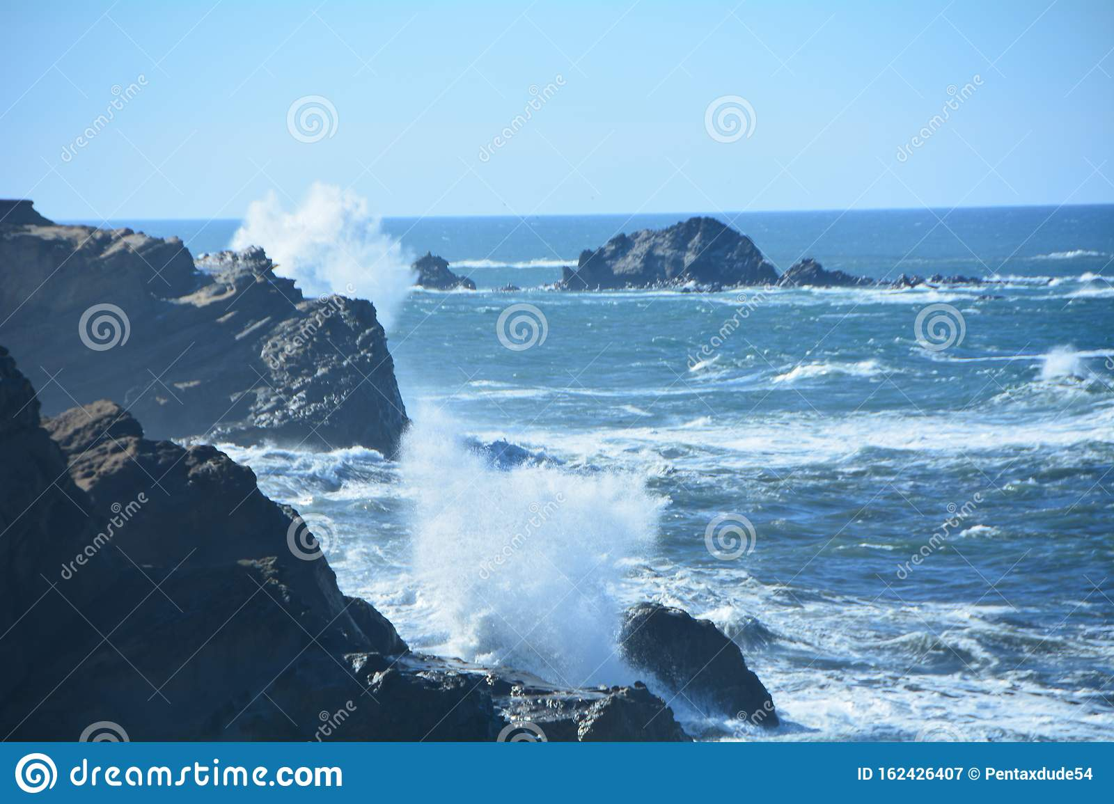 Two waves crash at Shore Acres State Park on the Oregon Coast
