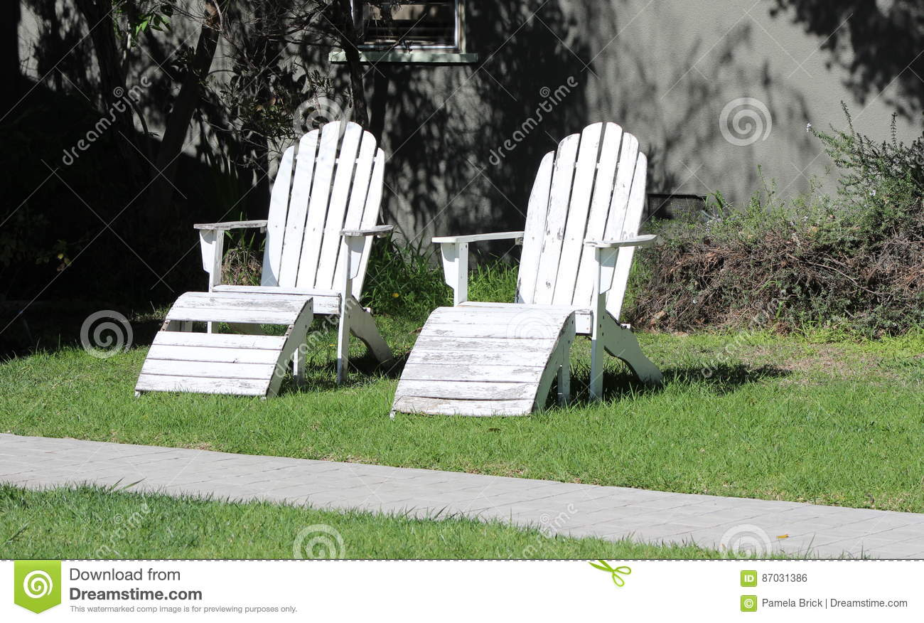 Two Weathered White Adirondack Chairs Symbols Of Old Age The Past
