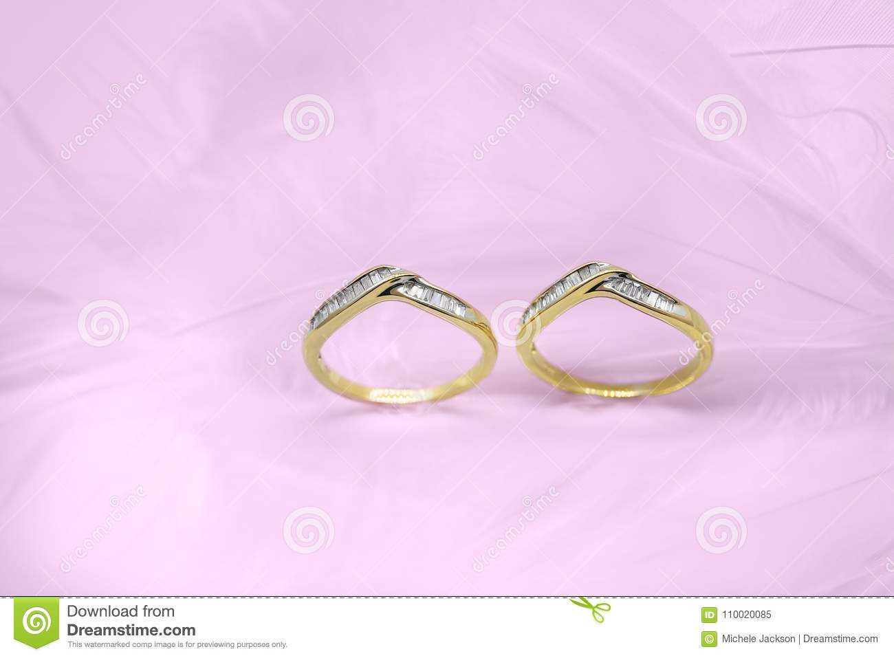 Two Wedding Bands On A Pink Background Stock Image - Image of ...