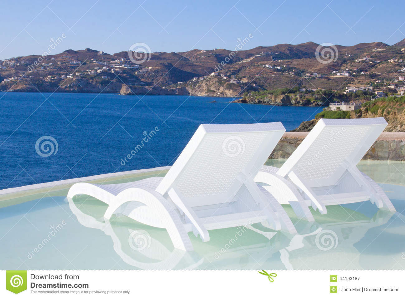 Two White Beach Chairs In Pool With Sea View In Greece Stock Image