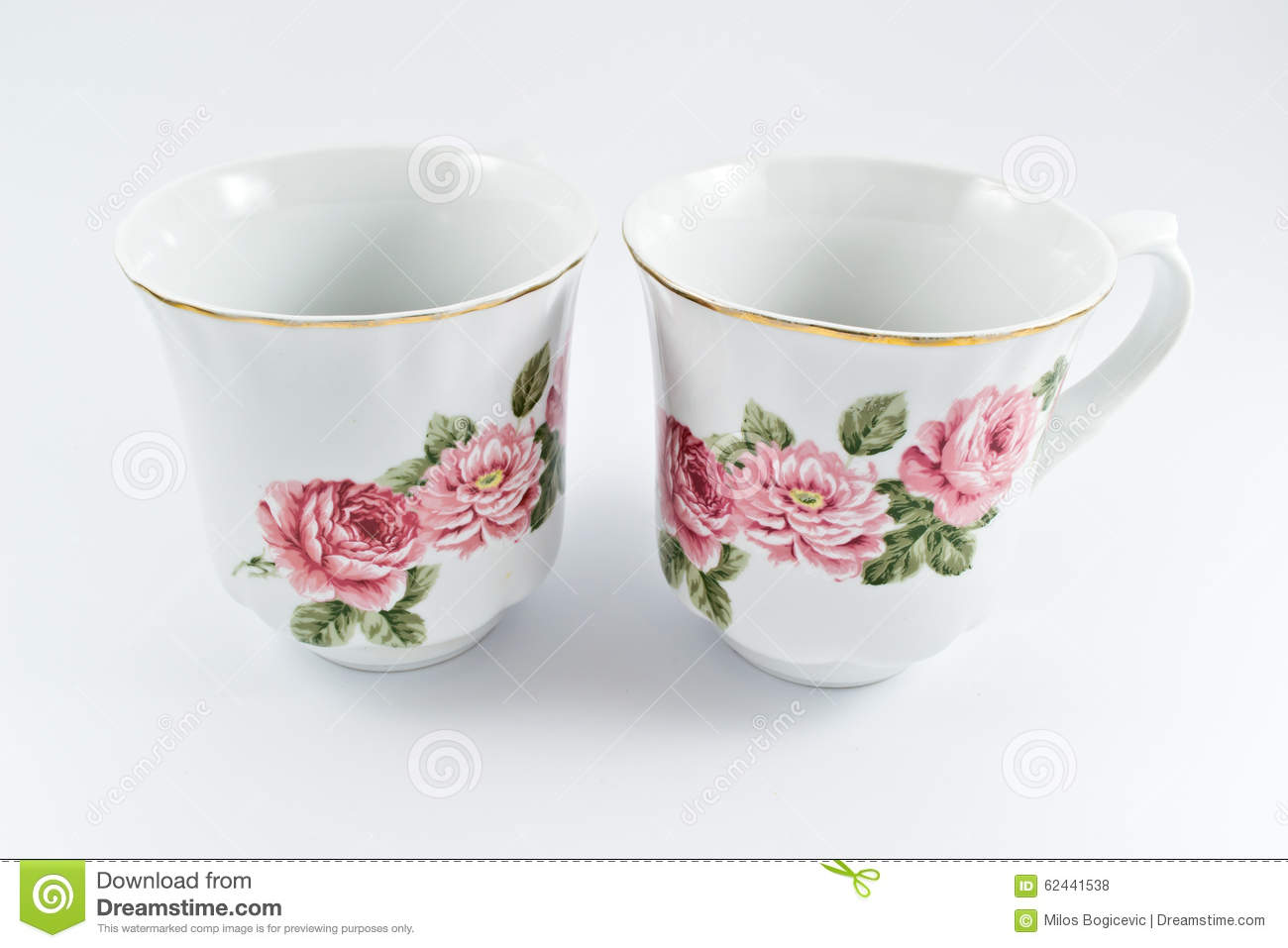 Two White Cups Of Coffee With Beautiful Flowers Stock