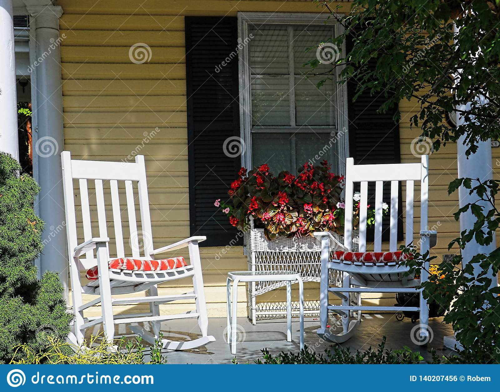 Awesome Two White Rocking Chairs Are On The Front Porch Of A Yellow Creativecarmelina Interior Chair Design Creativecarmelinacom