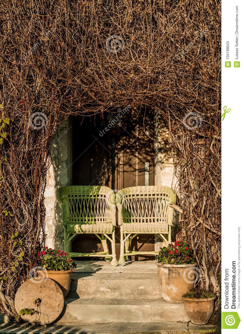 Two Wicker Vintage Chairs Standing On The Veranda Of Old House F ...