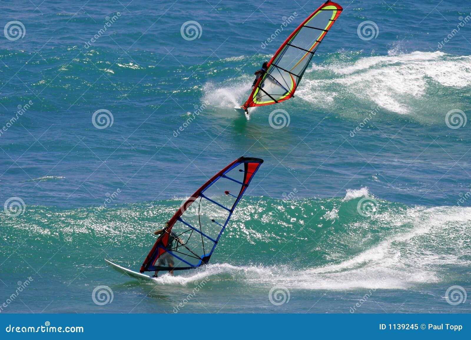 Two Windsurfers Windsurfing In Hawaii Stock Image - Image of board