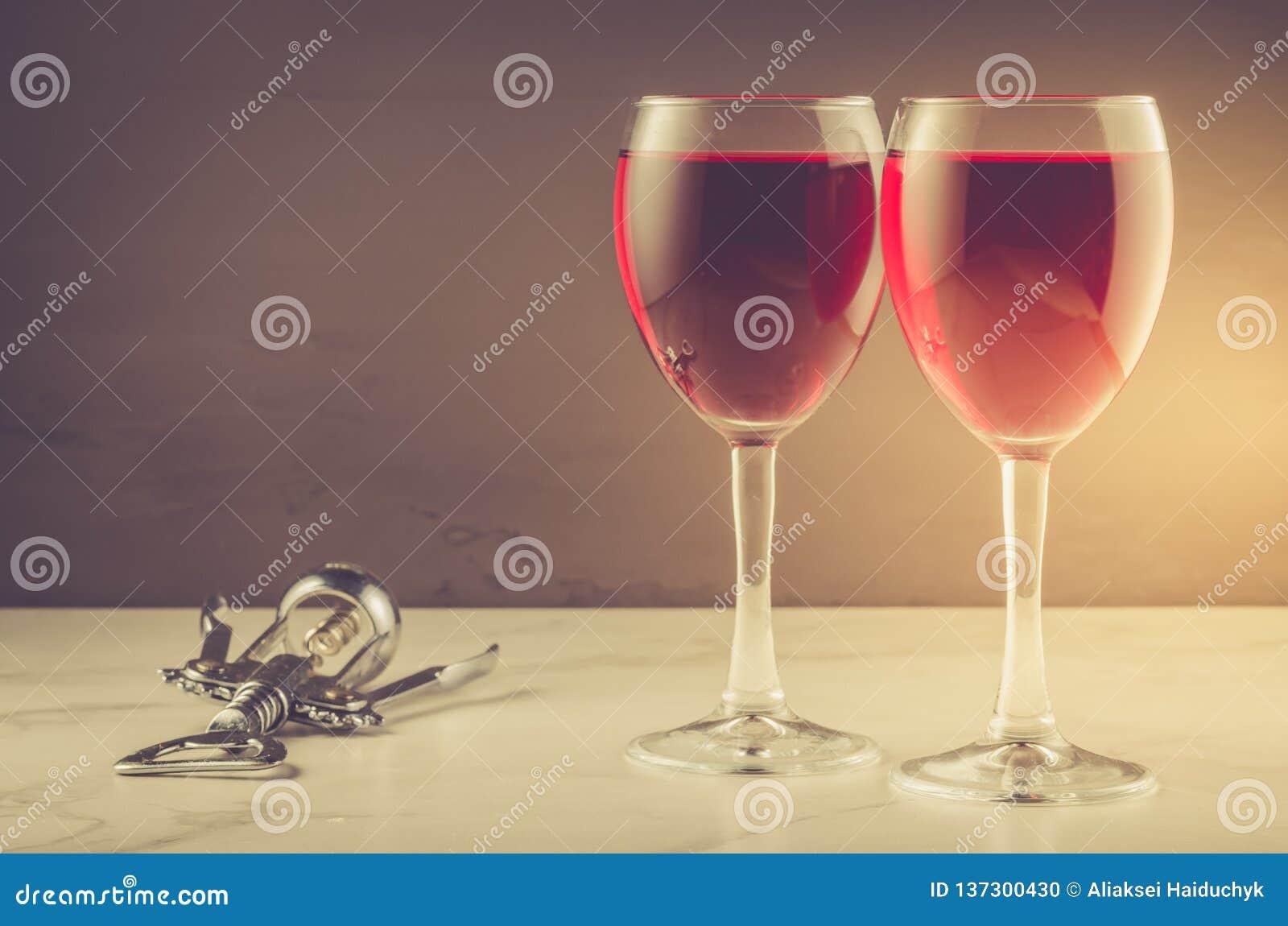 Two Wine glass and corkscrew on a dark background/ Two red Wine glass and corkscrew on a dark background. copyspace