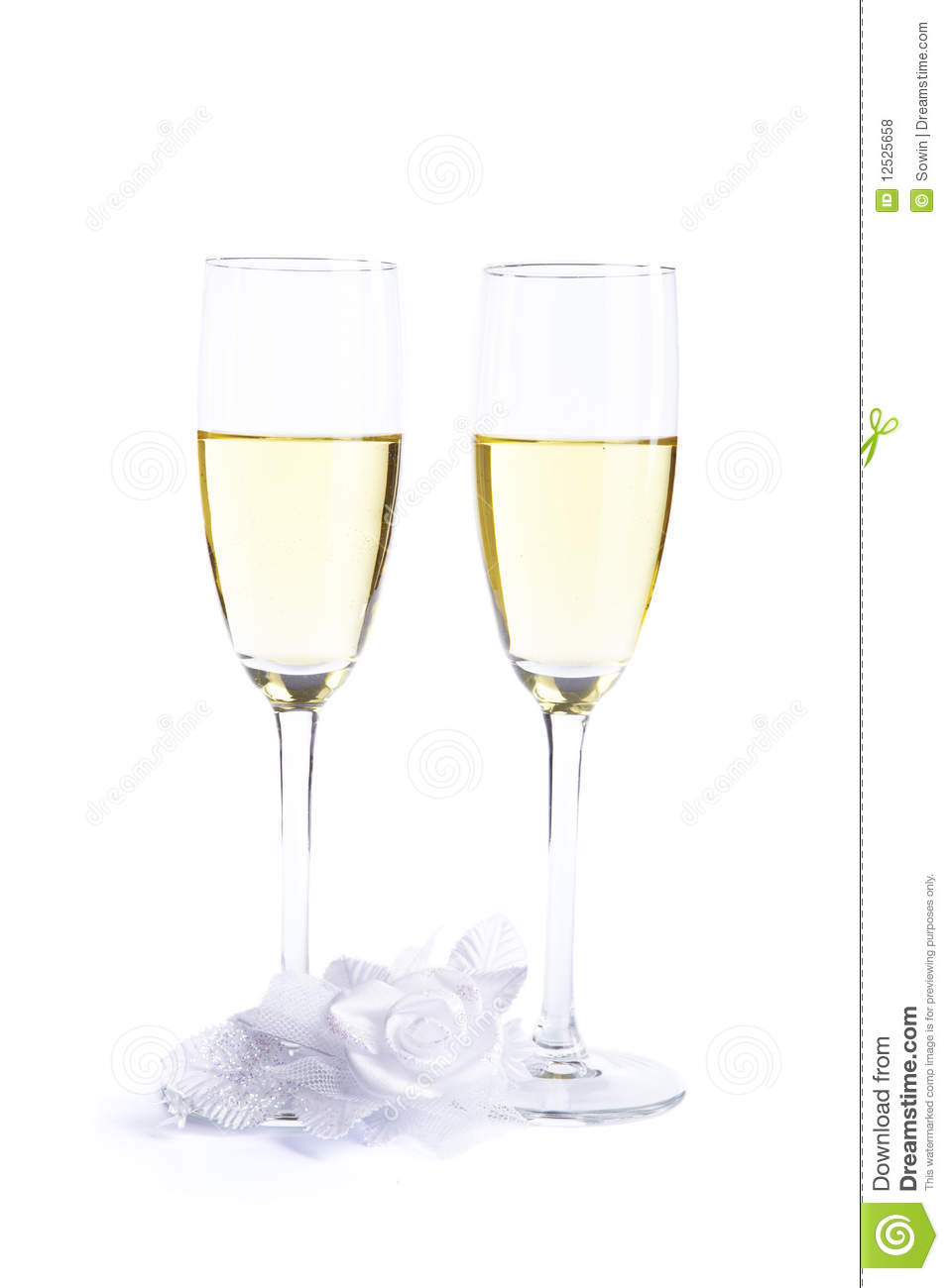 Two wine glasses with champagne and wedding flower