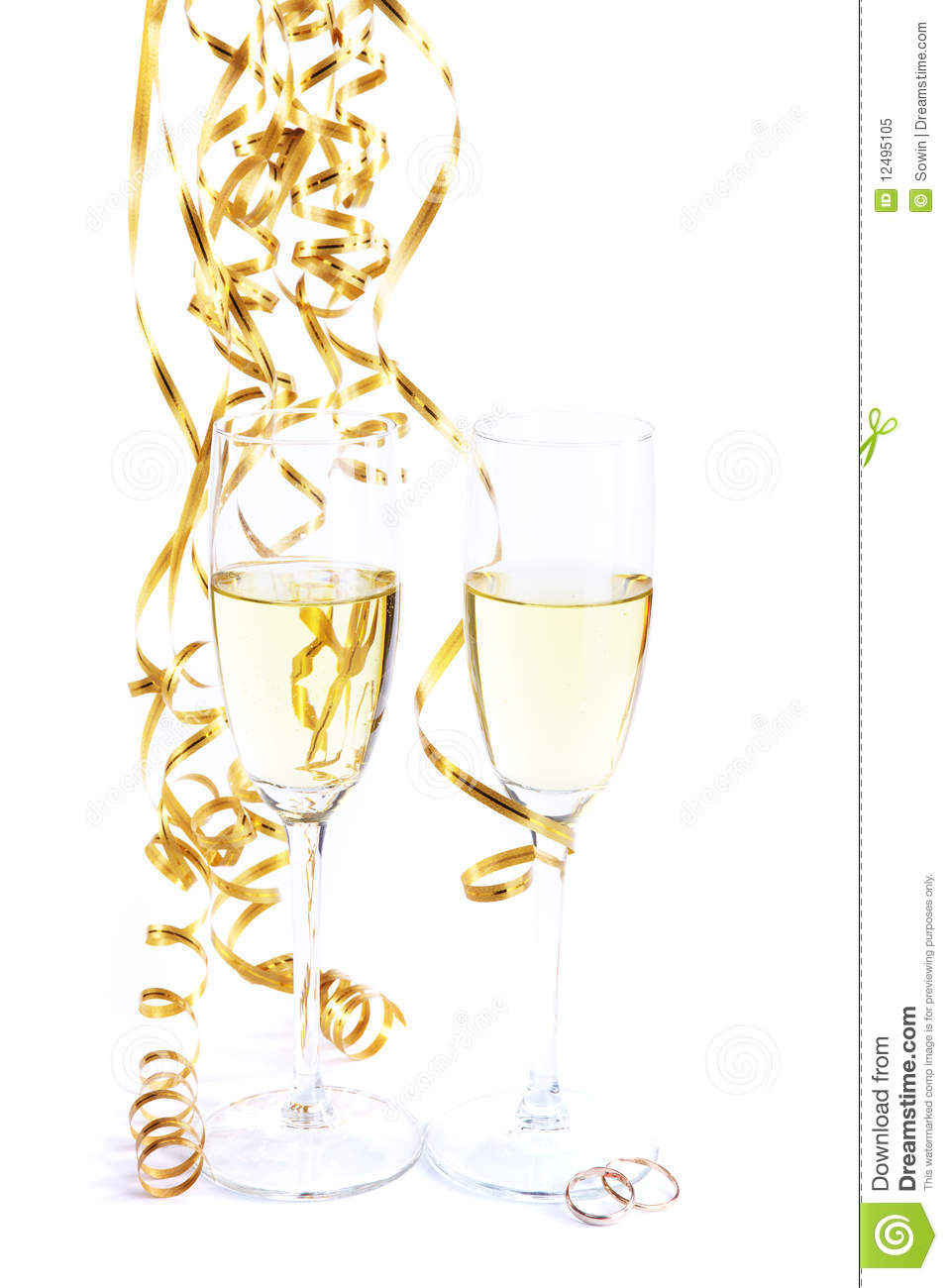 Two wine glasses and wedding rings