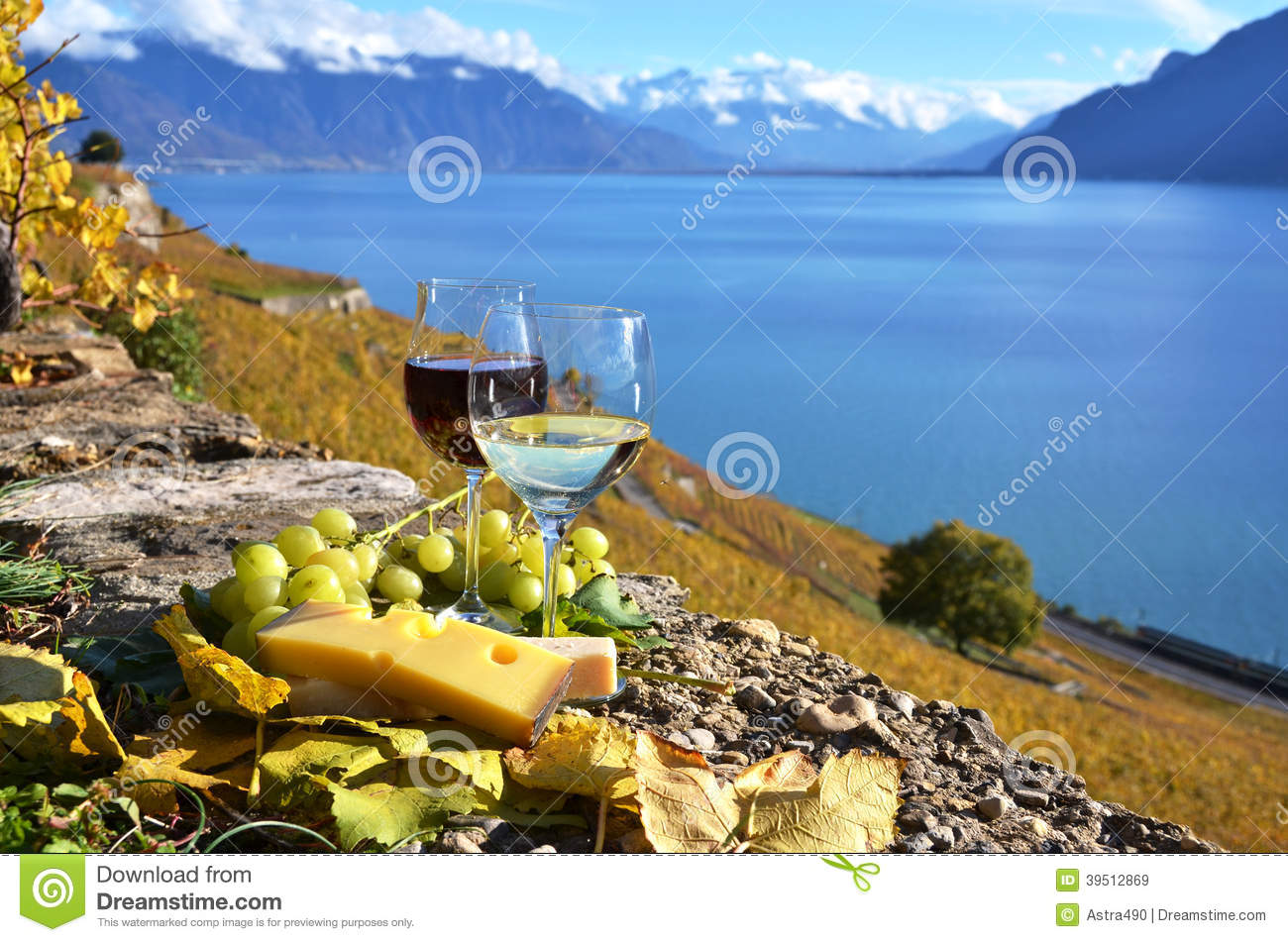 Two wineglasses, cheese and grapes