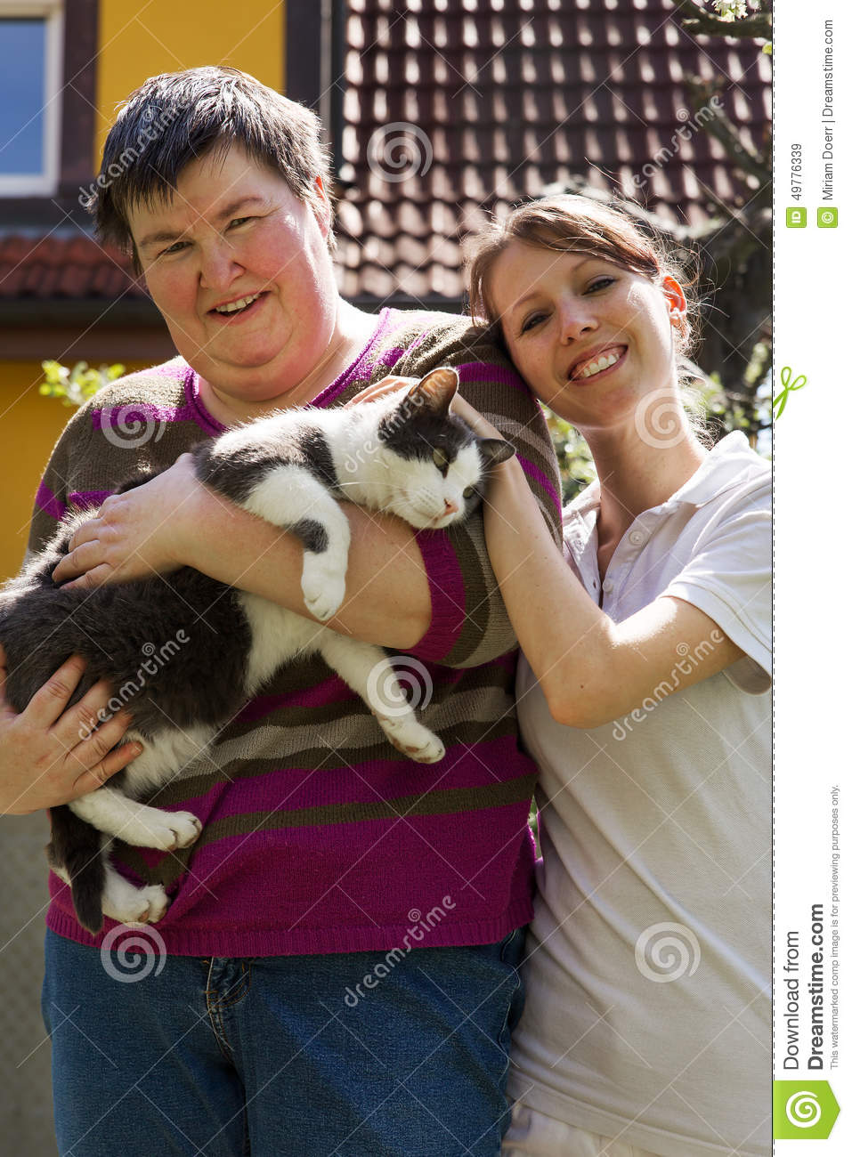 Two women and a cat