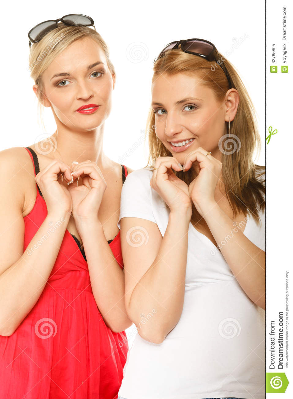 Two Women Doing Heart Shape Love Symbol With Hands Stock Photo