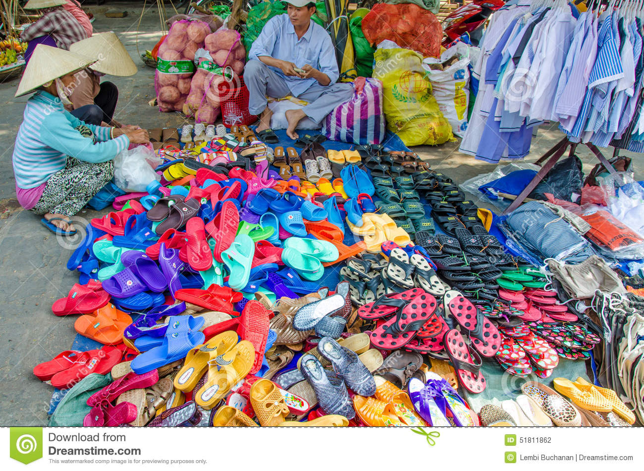 Sandals shoes sale - Two Women Examine The Colorful Sandals And Shoes For Sale At An Outdoor Market In Chan