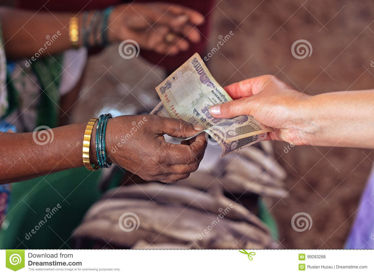 Two women exchanging money