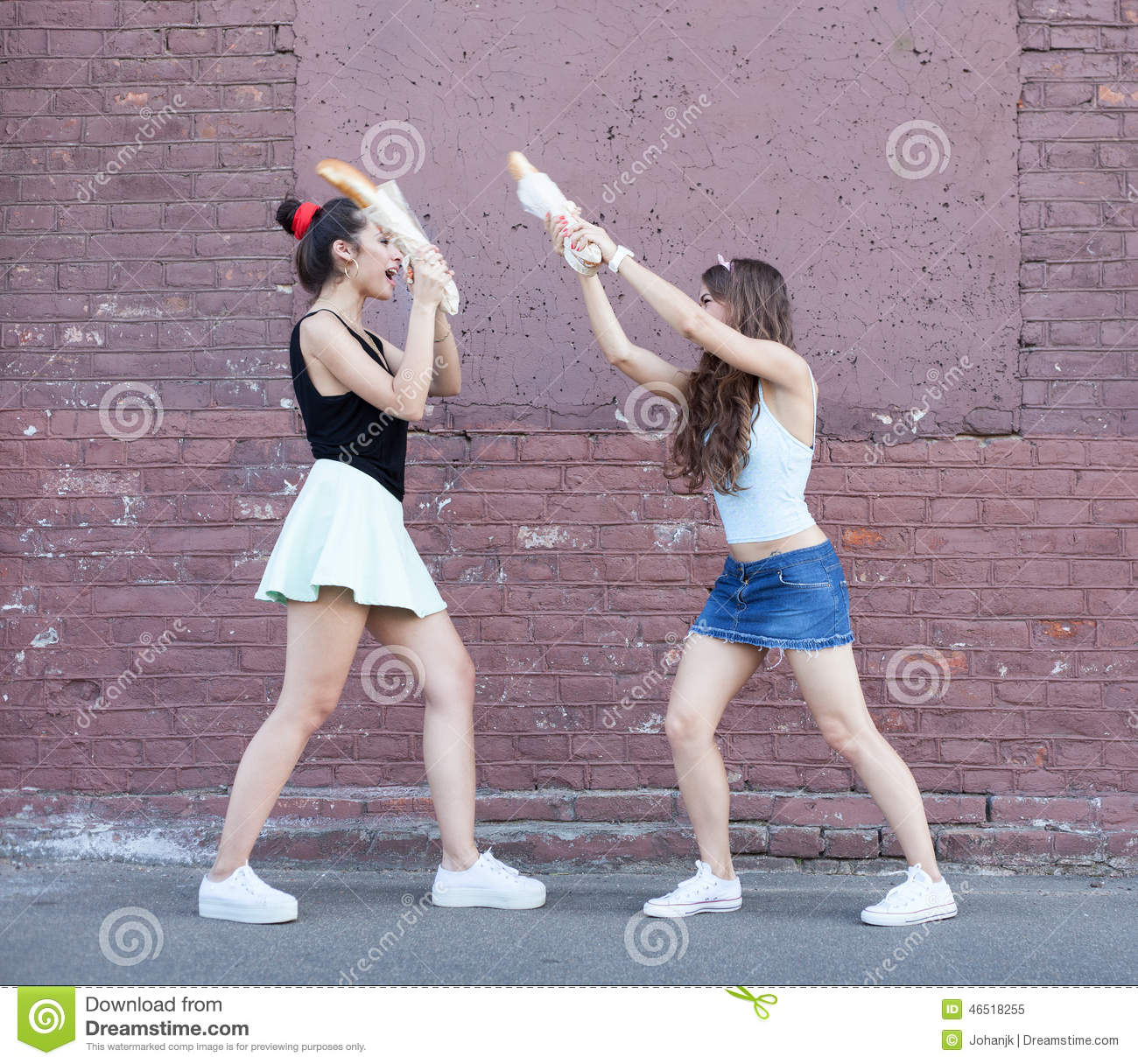 Two Women Fighting Bread Stock Photo