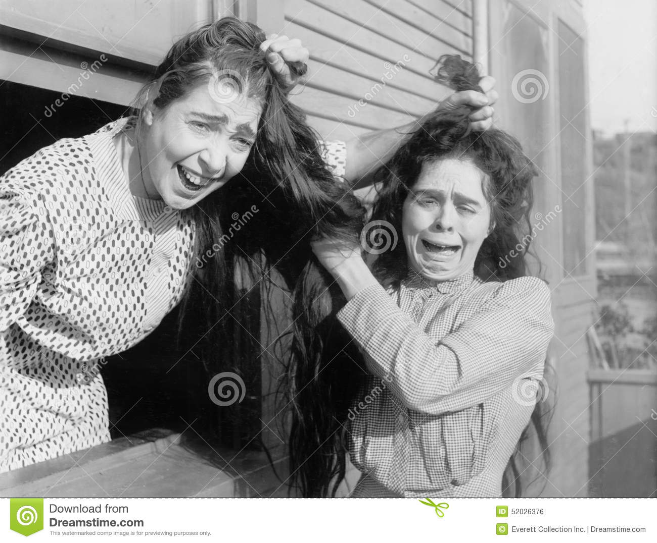 Two women fighting and pulling each others hair