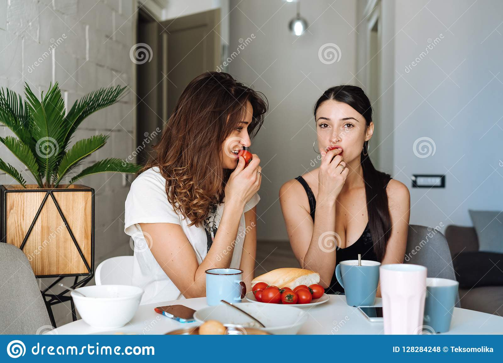 Two Woman Friends Breakfast In The Kitchen Stock Photo - Image of ... 52f971053