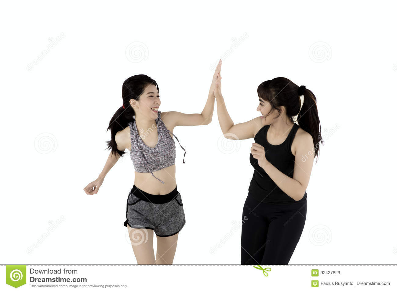 two women giving high five in studio stock image image of hand