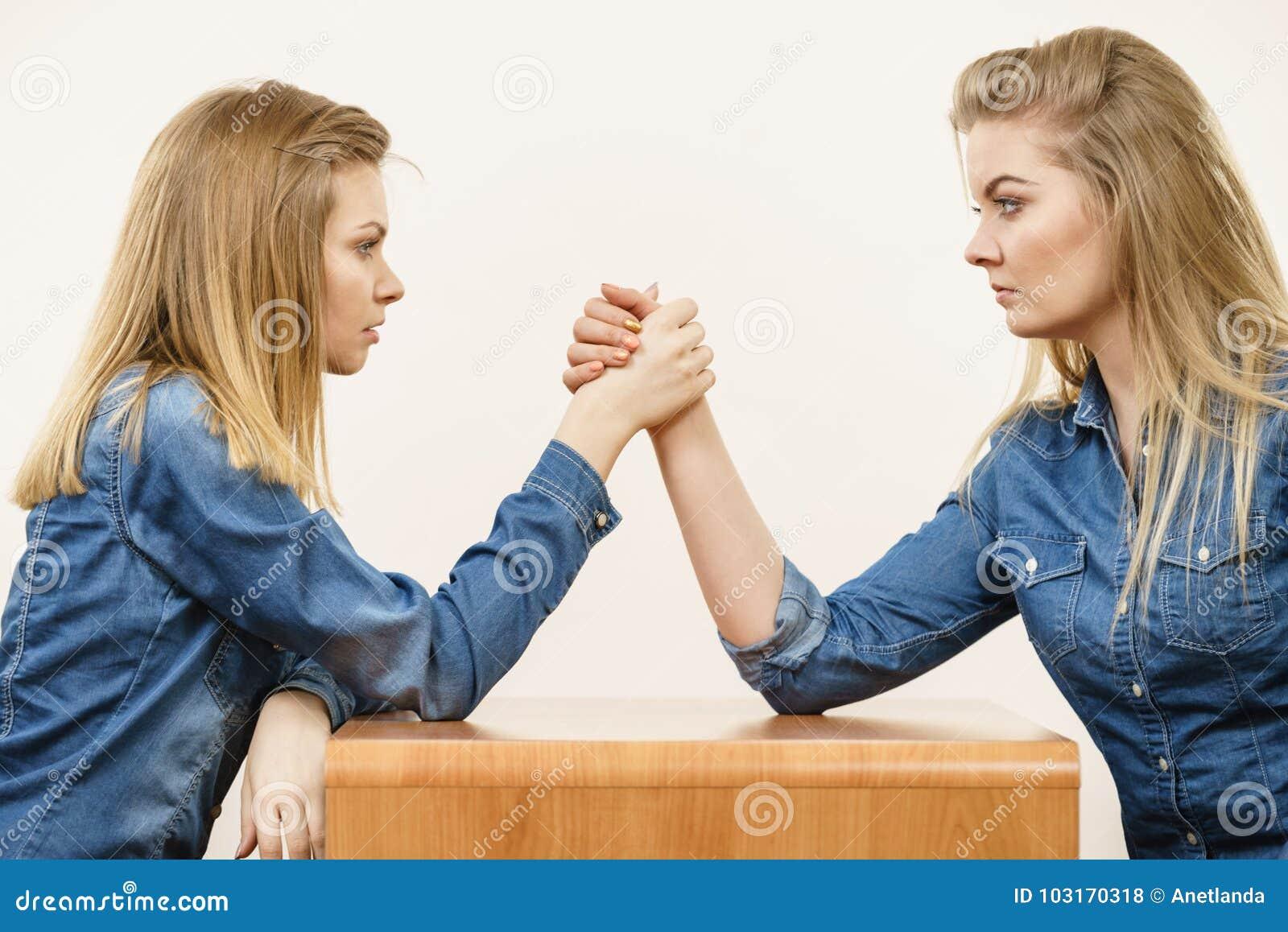 Two brunett lesbians wrestling