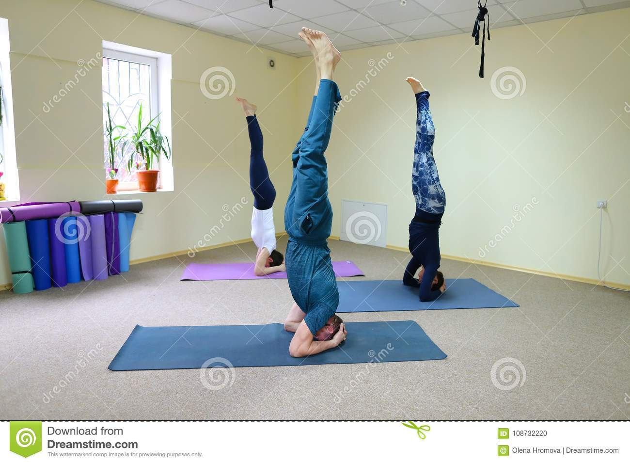 Three Young People Doing Yoga At Fitness Studio Stock Photo Image