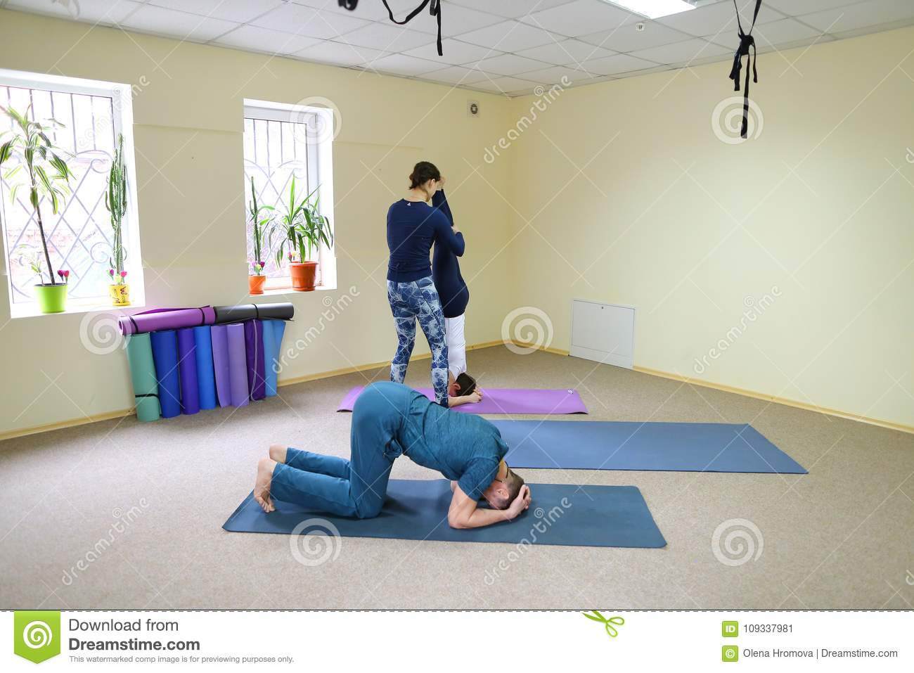 Three Young People Doing Yoga At Fitness Studio Stock Image Image
