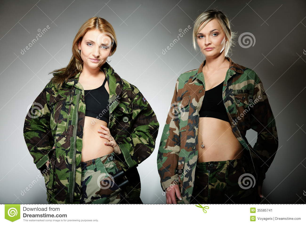 Two women in military clothes army girls on gray background