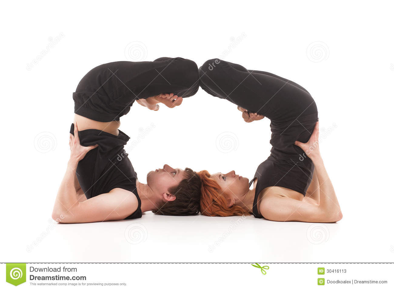 Group yoga. Two women and one men practicing yoga on a white ...