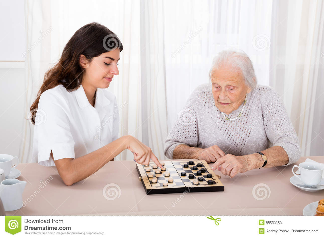 Two Women Playing Checkers Game