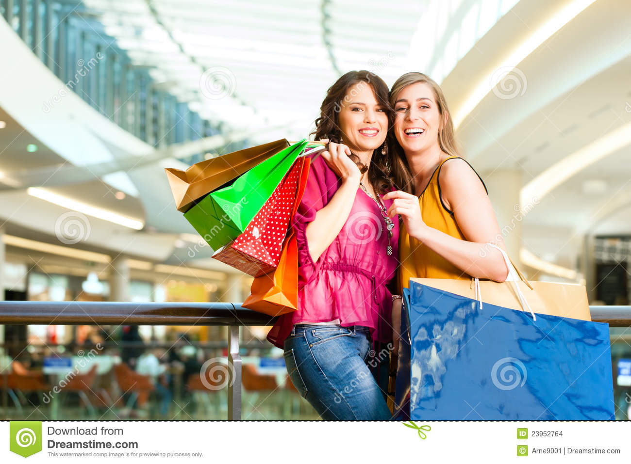 two-women-shopping-bags-mall-23952764.jpg