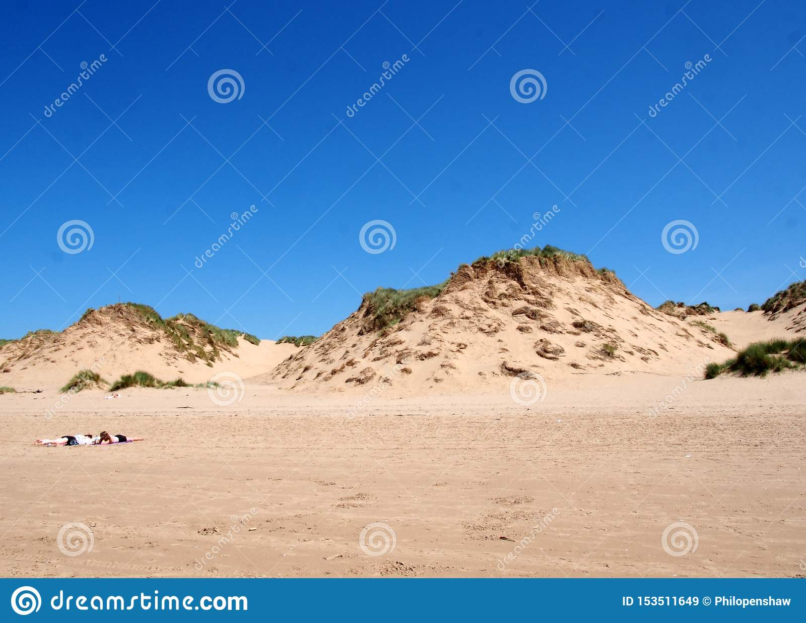 Two Women Doing Cartwheels On The Beach In Slow Motion