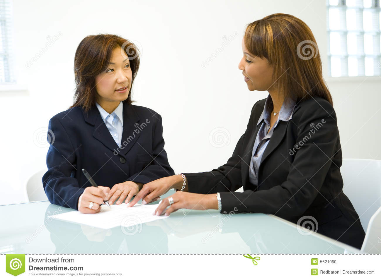 two women talking business stock photo  image of brunette