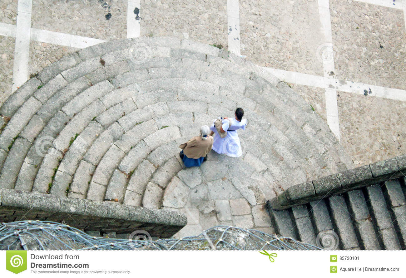 Two Women Walking Down The Stairs In The Street Of Porto Portugal