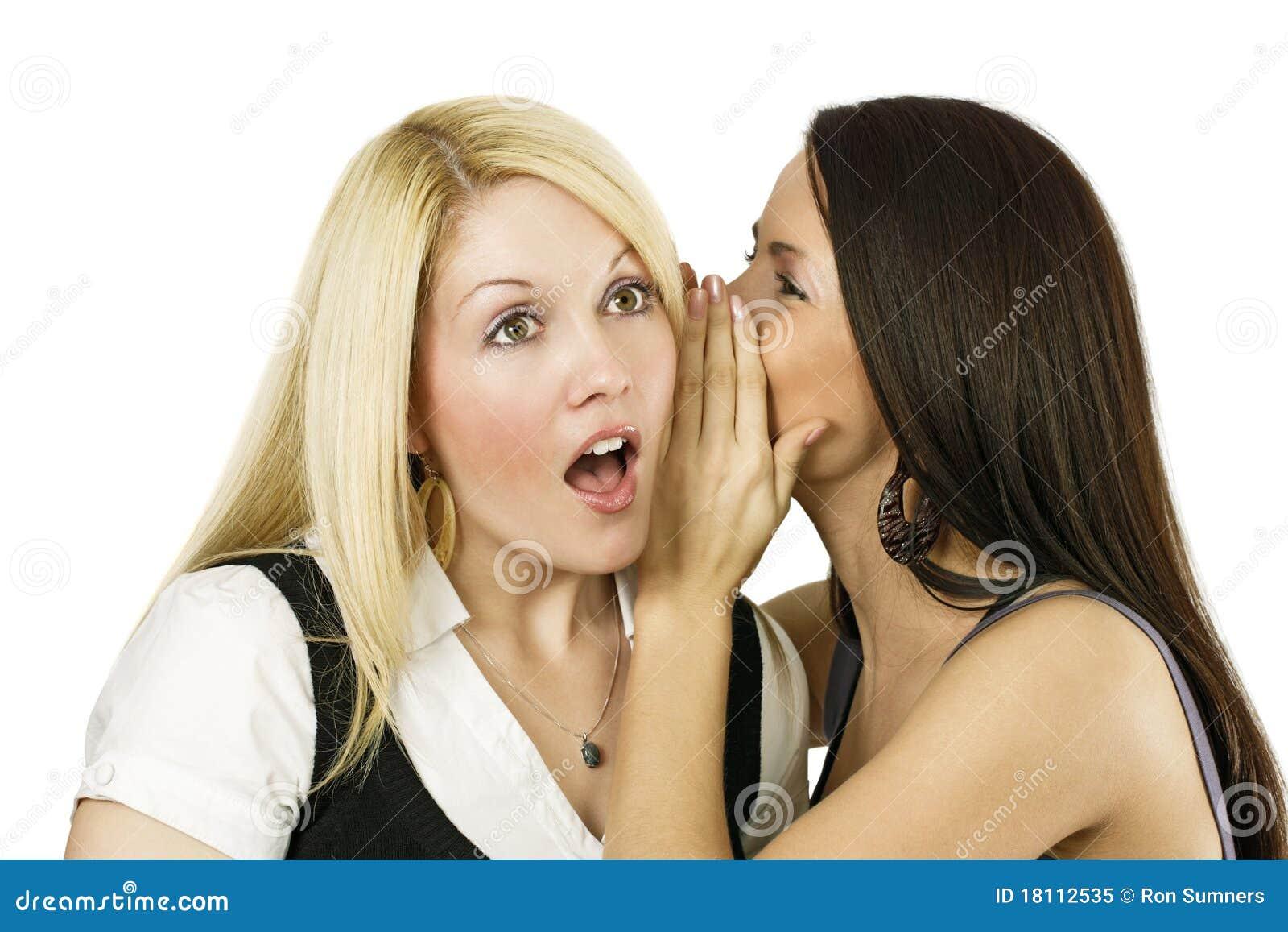 Two women whispering secrets
