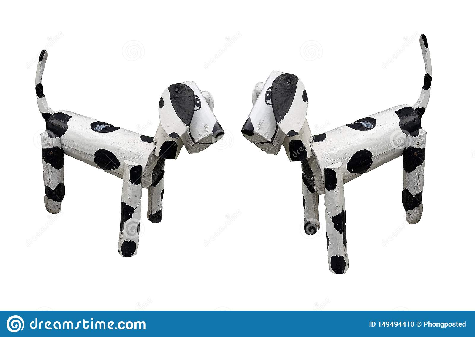 Two wooden dogs standing white mixed black colors isolated on white background