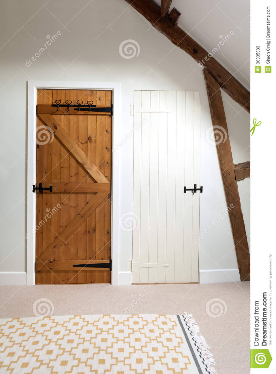Two wooden doors in a loft stock photos image 36335833 for Wood doors painted white