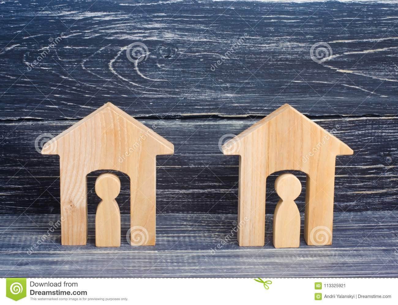 ec6518ba959 Two wooden houses with people on a black background. The concept of the  district