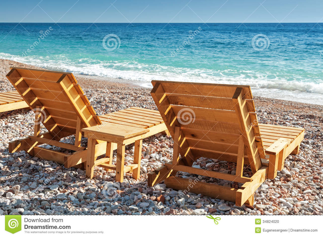 two wooden sun loungers on adriatic sea coast stock photo. Black Bedroom Furniture Sets. Home Design Ideas