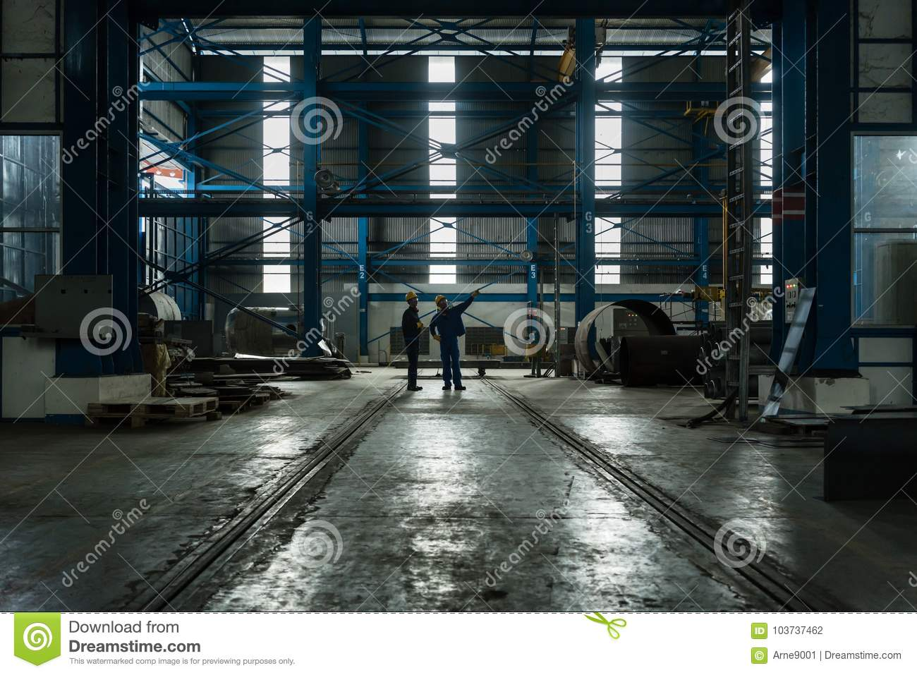 Two workers planning manufacturing process