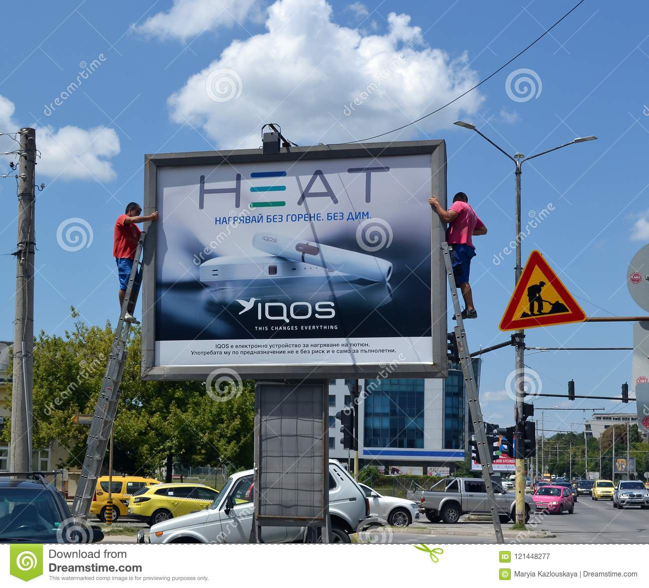 Two Workers Set An Advertising Poster For Electronic Cigarettes Iqos