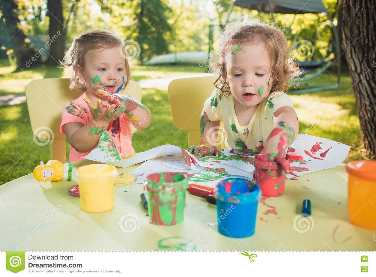 Download Two-year Old Girls Painting With Poster Paintings Together Against Green Lawn Stock Photo - Image of development, against: 74423570