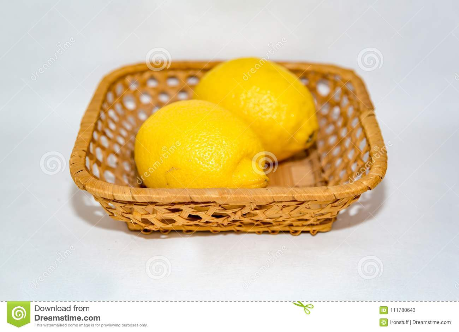 Yellow lemons in a basket