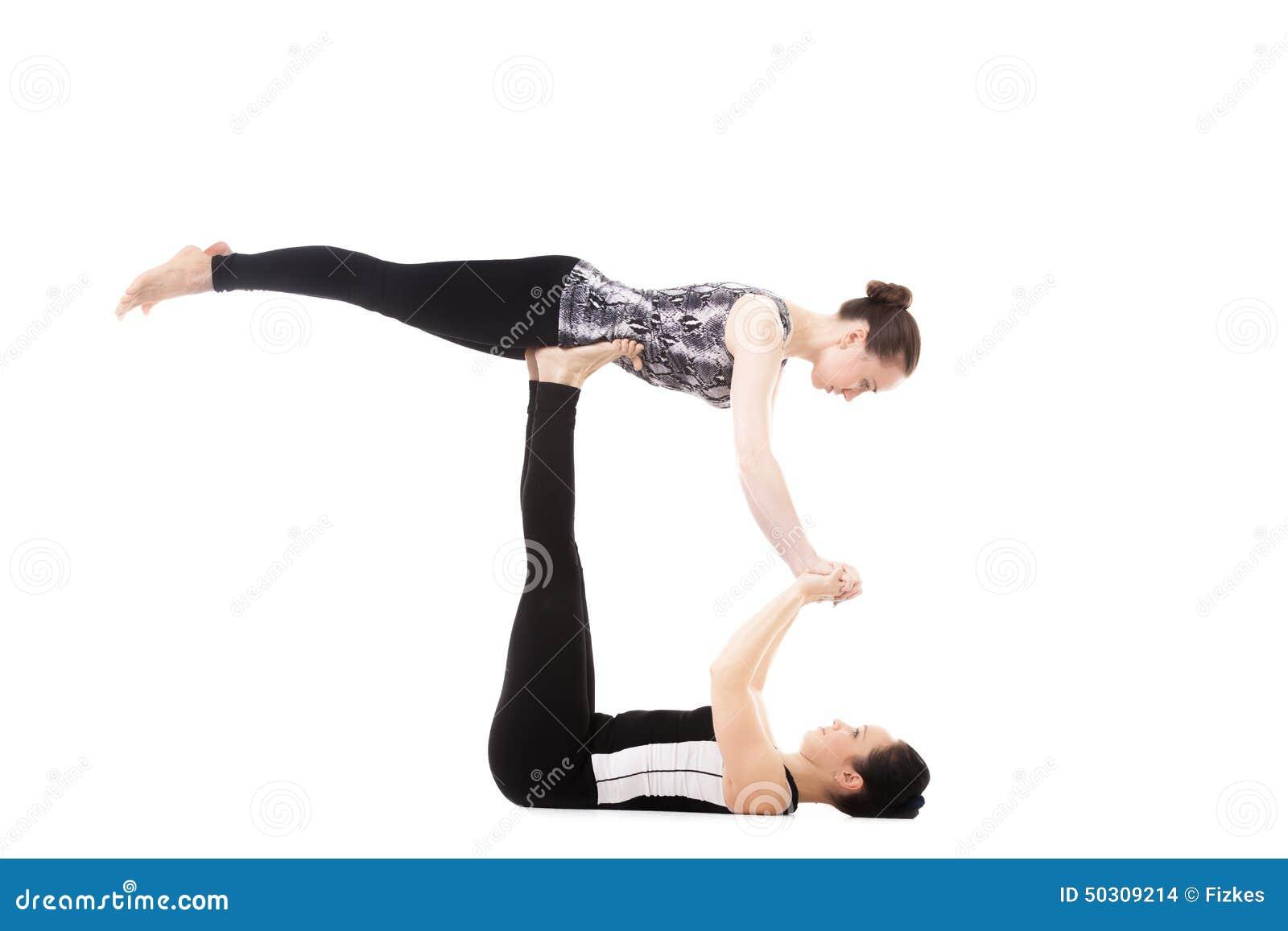 Fabulous Two Yogi Female Partners Doing Yoga Exercises Stock Photo - Image  VP38