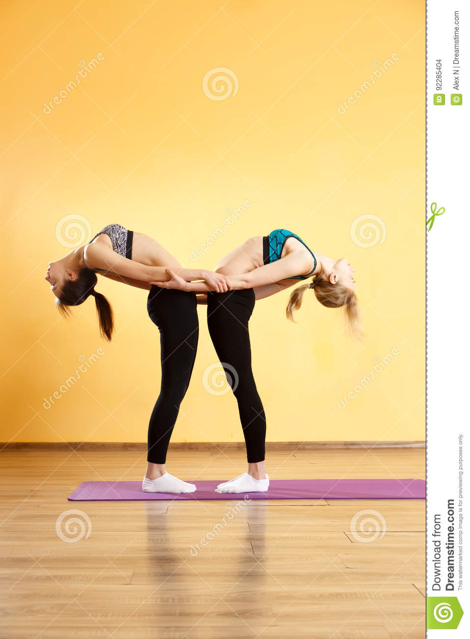 Two young athletes do yoga stock photo. Image of group - 40